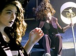 Lock up your lampshades: Lorde performs a bizarre stage act with the lounge room object during the 2014 MuchMusic Video Awards in Canada