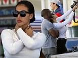 Reggie Bush's new girl looks just like ex Kim Kardashian in designer shades... and she loves selfies too