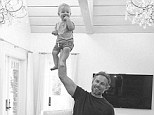 Father and son: Jessica Simpson shared this picture of fiance Eric Johnson holding baby Ace aloft on Instagram on Sunday