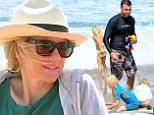 Paying homage to her homeland! Naomi Watts dons green and gold 'Australia' top during Father's Day beach outing with Liev Schreiber and their sons
