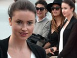Don't rain on my birthday! Under-dressed Emma Miller takes to the high seas at St. Tropez with gal pals Jessica Szohr and Nina Dobrev in spite of gloomy weather