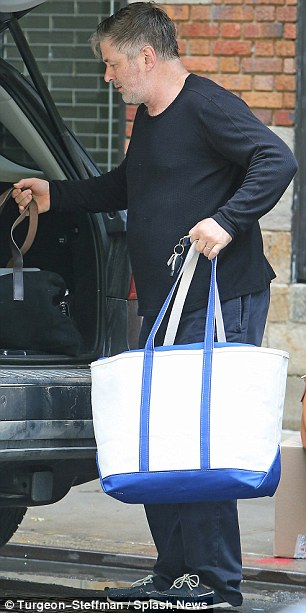 Busy Baldwin: The Blue Jasmine star made a few trips to his vehicle on the humid day