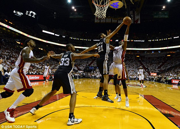 Blocked: San Antonio Spurs forward Tim Duncan stops the shot from Miami's Chris Bosh