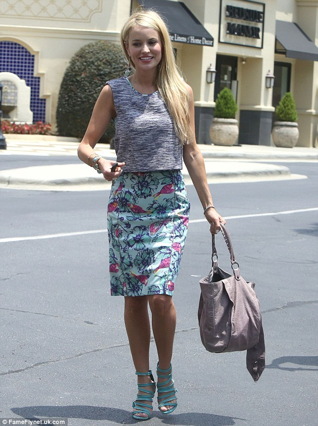 Not long to go! Emily sported a secret smile as she ran errands on Saturday morning ahead of her surprise wedding