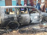 A burnt out van in the town of  Mpeketoni following an attack by Somali militants