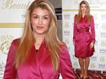 Return of the mac: Amy Willerton suffers a fashion fail in bright pink satin trench coat at modelling event