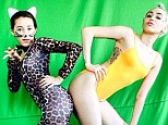 The next generation Miley! Cyrus poses with her sister Noah, 14, who is dressed in animal print catsuit for video shoot on Monday