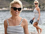 The 46-year-old lifeguard legend hit the beach of Isola Bella in a white and navy dress during the 60th Taormina Film Fest in Italy