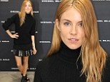 Sienna Miller looks good in all black as she dons sweater and mini-skirt at Diesel event