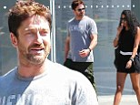 New fling? Gerard Butler was spotted with a mystery brunette in New York City on Monday