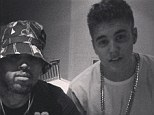 Justin Bieber shares photo with fans as he and Chris Brown head into the studio to record duet 'for the fans'