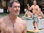 The name's Brosnan, Pierce Brosnan! Former Bond proves there's life after 007 by playing the action man on paddle board