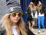 Poppy and Cara Delevingne leave home