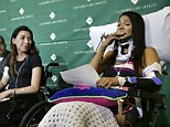 Emotional: Circus acrobats Julissa Segrera, (second from left, of the United States, and Dayana Costa, right, of Brazil,) are tearful as Costa reads a statement to members of the media at Spaulding Rehabilitation Hospital, Tuesday, June 17, 2014, in Boston
