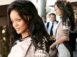 That's not like you! Rihanna goes business chic with an edge as she lunches in a short sleeved top tucked into a pencil skirt