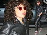 She's a disco diva! Lady Gaga goes hell for leather in all-black jumpsuit and sky-high platforms as she dons curly Seventies wig