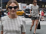 She's no square! Olivia Palermo takes fashion risk and teams checkered peplum top with matching black shorts