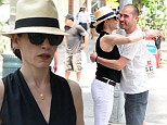 Hugging it out: Julianna Margulies cuts a stylish figure in Panama hat as she embraces male friend on streets of New York City