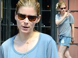 Make-up free Kate Mara dresses down in a baggy T-shirt and ill-fitting denim shorts
