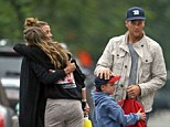 Blended: Gisele Bundchen embraces her husband Tom Brady's ex Bridget Moynahan after she dropped off her son with the NFL star on Father's Day