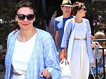 She's daring to bare! Maggie Gyllenhaal flashes a peaek of her midsection in two-piece white dress