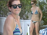 Fabulous at 46! Kate Walsh accentuates washboard stomach with delicate gold body chain as she soaks up the Miami sun in blue patterned bikini