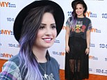 Demi Lovato is grunge chic in plaid rocker T-shirt and sheer skirt as she attends My Big Night Out music event