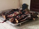Some of the dead football fans killed by a bomb explosion lie in the morgue in a government hospital in Damaturu, northern Nigeria