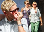 PICTURE EXCLUSIVE: Ellen DeGeneres shares a tender moment kissing wife Portia de Rossi's hand during a romantic stroll in New York
