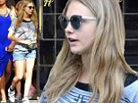 Just the tonic! Cara Delevingne puts on a long and leggy show in denim shorts as she grabs a green juice to go