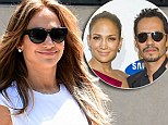 Jennifer Lopez flashes big smile while stepping out in NYC... as it's revealed she recently finalized divorce from Marc Anthony THREE YEARS after split