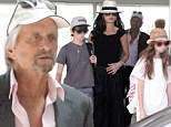 'Never take marriage for granted': Michael Douglas opens up about lessons learned from Catherine Zeta-Jones split ONE YEAR ago... as they arrive in Barcelona