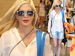 Tori Spelling shows off her skinny legs in denim shorts while shopping after claiming she 'eats like a truck driver'