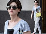 Did you forget to change? Anne Hathaway displays her long slender legs through striped pyjamas