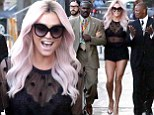 She's got a lot of front! Kesha wears see-through black top and hot pants to Jimmy Kimmel Live