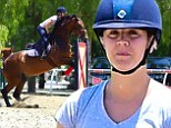 Easy rider! Kaley Cuoco is poised while practicing her show jumping moves atop horse Apollo at the equestrian center