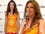 Shane who? Elizabeth Hurley makes a fiery entrance in figure-hugging orange dress as she steps out in Dallas amid ex's new romance rumours