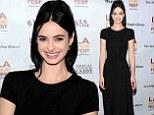 Krysten Ritter displays super slim frame in elegant black dress as she arrives at The Road Within premiere