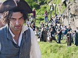 Aidan Turner pictured filming Poldark adaptation in Cornwall as production moves to the dramatic Botallack coastline