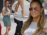 Sealed with a kiss! A newly divorced Jennifer Lopez steps out in sexy padlock heels and a pair of giant lips across her top