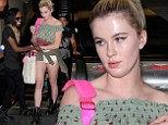 Ireland Baldwin gets a warm welcome from BFF Angel Haze as she jets into LAX displaying her long legs in a pair of tiny white denim hot pants