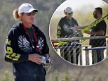 Bruce Jenner flies helicopter