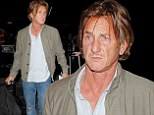 2662273 Missing his Penn pal? Sean looks glum without girlfriend Charlize Theron as he gets ready to jet out of Los Angeles