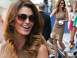 Still stunning: Cindy Crawford, 48, shows off knockout legs in tight leather dress paired with snakeskin heels during NYC outing