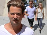 Going strong: Sean Stewart and girlfriend Sophia Mondi held hands on Wednesday while strolling in Beverly Hills, California