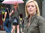 Playing the coquette? Jane Krakowski flatters her cargo dress with pink-checkered parasol during sunny stroll in NY