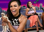 Animal lover: Rosario Dawson was thrilled to hold a young albino alligator on Wednesday during her appearance on the The Tonight Show with Jimmy Fallon