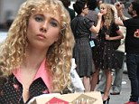 She's found her niche! Juno Temple sports garish make-up and a messy permed hairdo as she films untitled '70s HBO Rock'n'Roll project in Times Square