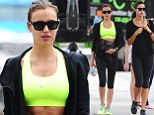 Irina Shayk shows off the fruits of her labour as she displays toned figure in neon green crop top and black leggings