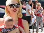Precious cargo: Gwen Stefani, the new The Voice coach arrived at her five-year-old son Zuma's kindergarten graduation with her littlest bundle of joy, four-month-old son Apollo